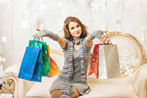 Photo Christmas Brown haired Sit Present Smile Hands Paper bag Dress Purchase Girls