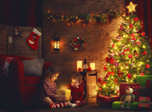 Images New year Candles Christmas tree Balls Fairy lights Present Little girls Boys 2 Children
