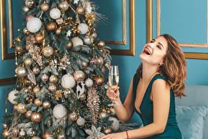 Photo Christmas Champagne Brown haired Happy Stemware New Year tree Balls Girls