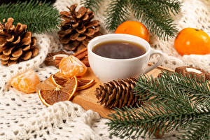 Pictures Christmas Coffee Mandarine Cup Branches Pine cone Food