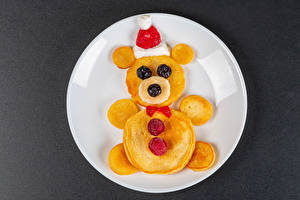 Image New year Creative Pancake Raspberry Berry Teddy bear Gray background Plate Food