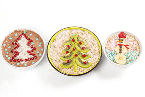 Wallpaper Christmas Muesli Oatmeal Creative Kiwi Pomegranate White background Christmas tree Snowman