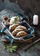 Fotos Neujahr Keks Kerzen Rosinen Schneemänner