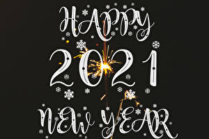 Pictures New year Snowflakes 2021 Text English Sparkler Black background