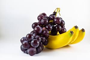 Fotos Hautnah Bananen Trauben Grauer Hintergrund Lebensmittel