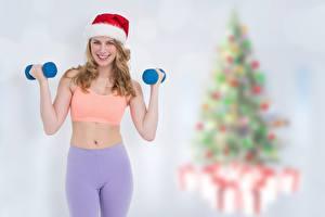 Bilder Fitness Neujahr Unscharfer Hintergrund Mütze Lächeln Hand Hanteln Mädchens