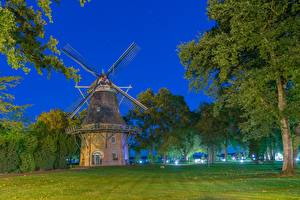 Pictures Germany Night Grass Trees Windmill