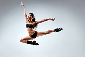 Picture Gray background Jump Dancing Pose Hands Legs young woman