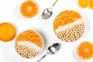 Pictures Oatmeal Orange fruit White background Spoon