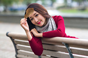 Pictures Asiatic Blurred background Bench Hands Leaf Staring young woman
