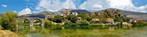 Desktop hintergrundbilder Bosnien und Herzegowina Fluss Brücke Gebirge Haus Trebinje, panorama Städte