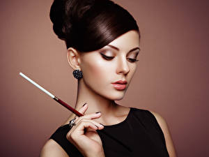 Pictures Brown haired Face Hands Makeup Earrings Modelling young woman