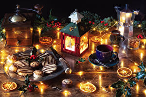 Wallpapers New year Still-life Berry Candles Kettle Cookies Branches Cup Fairy lights
