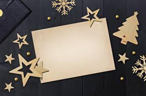Bureaubladachtergronden Nieuwjaar Wenskaart Sjabloon Kerstboom Kleine sterren Papier blad