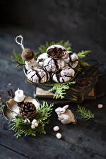 Photo Cookies Candles Wood planks Branches Pine cone Snowmen