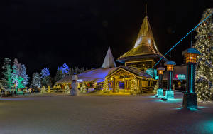 Images Finland Lapland region Christmas Houses Winter Night time Christmas tree Fairy lights Snow Snowmen Street lights Saariselka