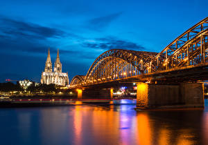 Wallpapers Germany Cologne River Bridge Temples Church Evening Street lights Hohenzollern Bridge and Cathedral Cities