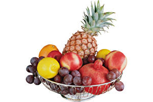 Picture Grapes Pineapples Apples Lemons White background