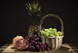 Wallpaper Grapes Pomegranate Pineapples Gray background Wicker basket