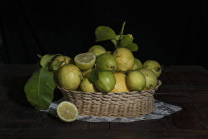 Pictures Lemons Many Black background Wicker basket