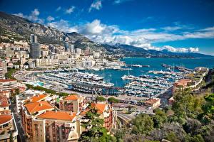 Bureaubladachtergronden Monte Carlo Monaco Jachthaven Jacht Motorboot Gebouwen een stad