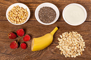 Picture Oatmeal Nuts Raspberry Bananas Muesli Wood planks Grain Cream Healthy eating Bowl