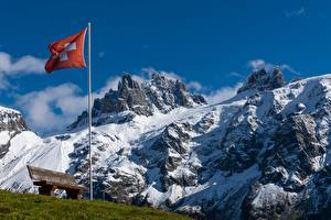 Fotos Schweiz Gebirge Flagge Bank (Möbel) Gras Schnee Alpen Natur
