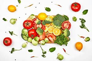 Photo Vegetables Tomatoes Broccoli Dill Lemons Chili pepper White background Cutting board Food