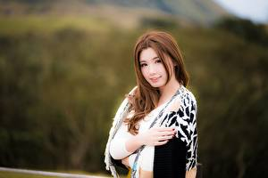 Pictures Asiatic Blurred background Brown haired Glance Hands Girls
