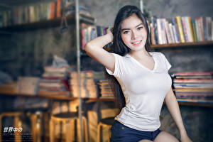 Pictures Asian Bokeh Brunette girl Glance Smile Hands young woman