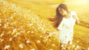 Image Asiatic Blurred background Grass Dress Brown haired young woman