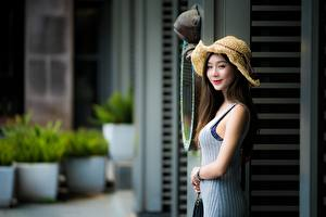 Pictures Asian Blurred background Hat Smile Hands Girls