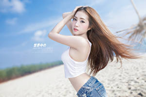 Pictures Asian Pose Brown haired Hands Staring Blurred background young woman