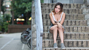 Picture Asiatic Stairway Sitting Decollete Hands Legs female