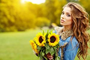 Pictures Bouquets Sunflowers Izabela Magier Bokeh Brown haired Staring young woman