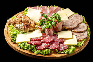 Picture Meat products Sausage Ham Cheese Vegetables Black background Sliced food