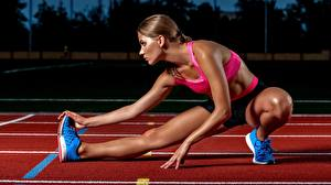 Photo Running Legs Stretch exercise young woman Sport