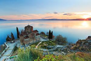 Picture Sunrise and sunset Church Lake Horizon From above St. john's Church, North Macedonia, Lake Ohrid