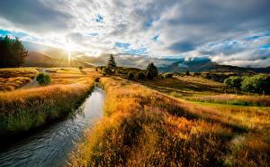 Photo Sunrises and sunsets Landscape photography HDRI Stream Grass Hill