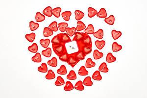 Fotos Valentinstag Kerzen Weißer hintergrund Herz das Essen