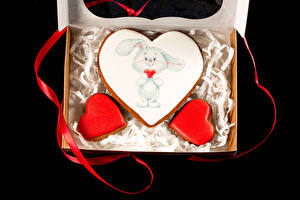 Photo Valentine's Day Cookies Rabbits Black background Design Ribbon Food