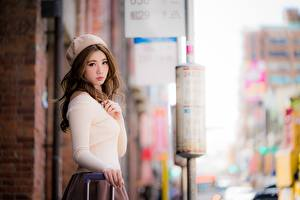 Pictures Asian Blurred background Brown haired Staring Beret Hands Girls