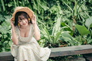 Pictures Asiatic Bokeh Sitting Hat Decollete Smile Dress Hands Girls