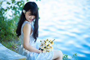 Picture Asian Bouquet Brunette girl Smile Sit Frock Hands Girls