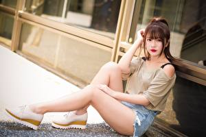 Pictures Asiatic Brown haired Sitting Hands Shorts Legs Stilettos Girls