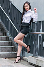 Pictures Asiatic Brunette girl Smile Legs Skirt Blouse Staring young woman