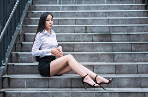 Pictures Asian Brunette girl Stairs Sit Legs Skirt Blouse female