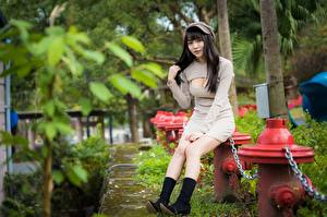 Picture Asian Chain Brunette girl Baseball cap Sitting Dress Hands Neckline Legs Wearing boots young woman