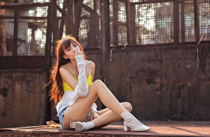 Pictures Asian Sitting Legs Sleeveless shirt Glance Brown haired young woman