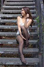 Photo Asian Staircase Brown haired Smile Sit Hands Legs Pantyhose young woman